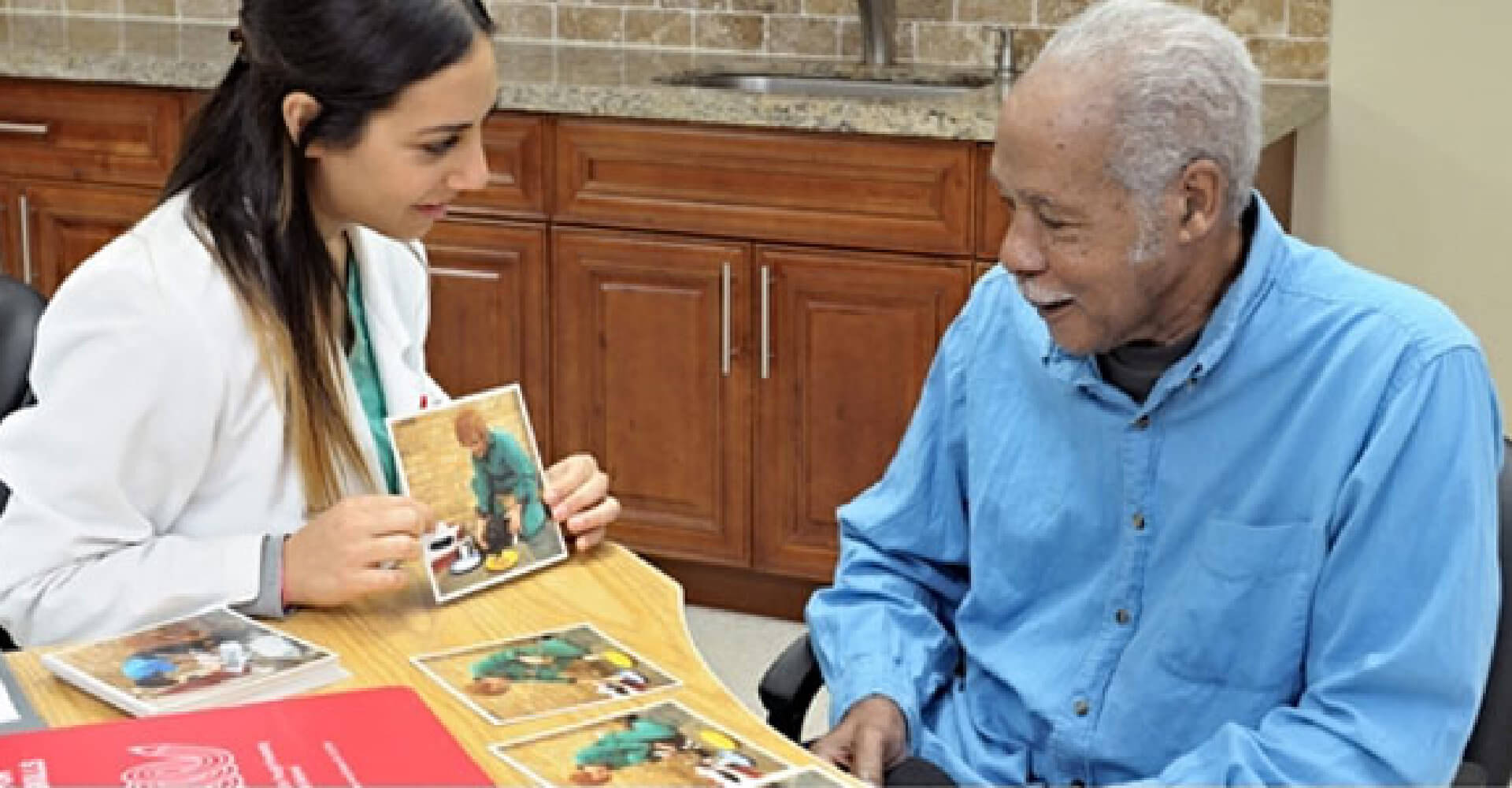 nurse showing picture to an old man