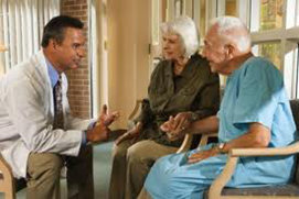 doctor talking to seniors