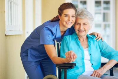 Nurse and senior woman smiling